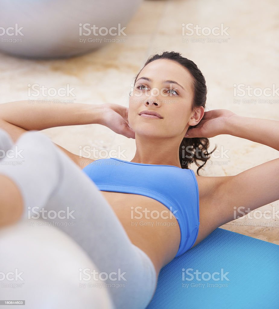 Working towards a toned midriff royalty-free stock photo