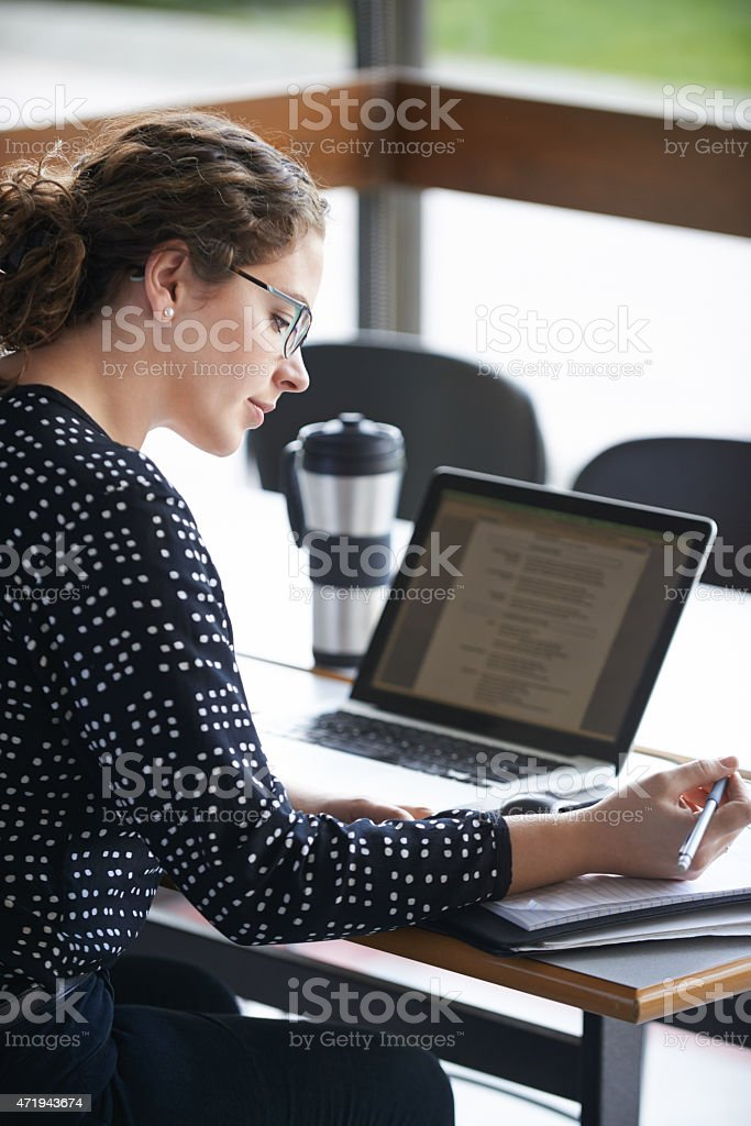 Working towards her degree stock photo