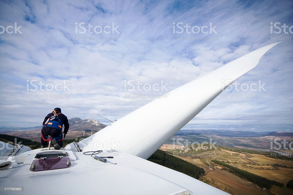 Working upon wind turbine stock photo