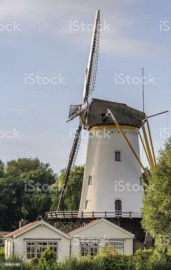 Working windmill against blue sky royalty-free stock photo