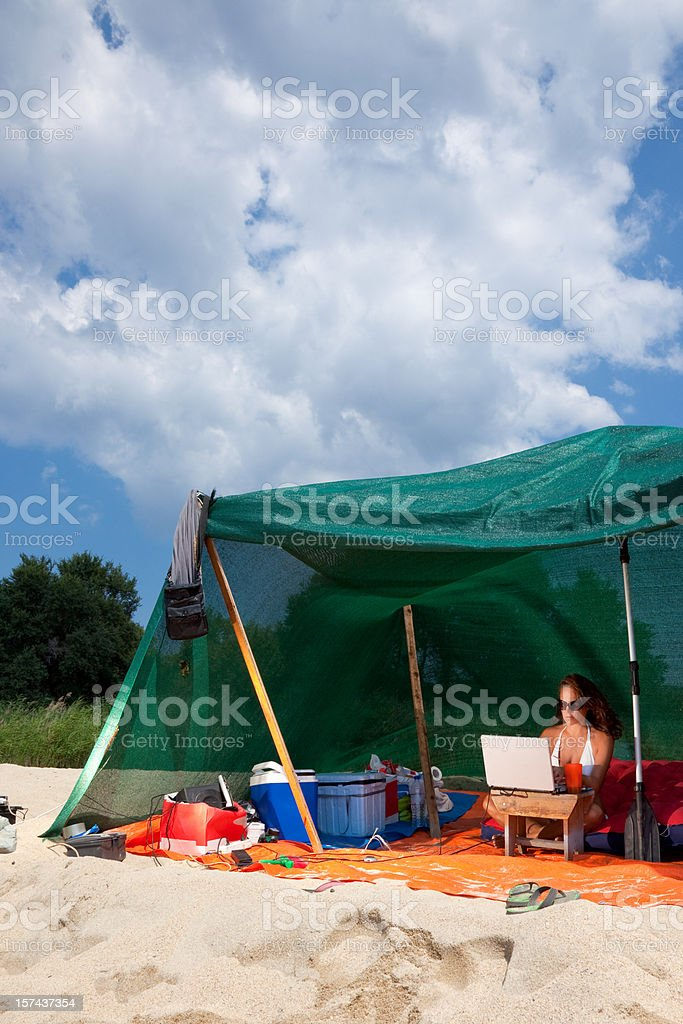 Working wireless in a beach tent royalty-free stock photo