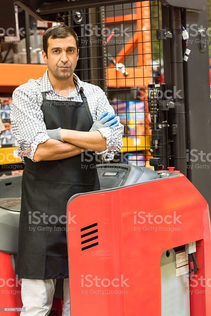 Working with a forklift in a timber/lumber warehouse stock photo