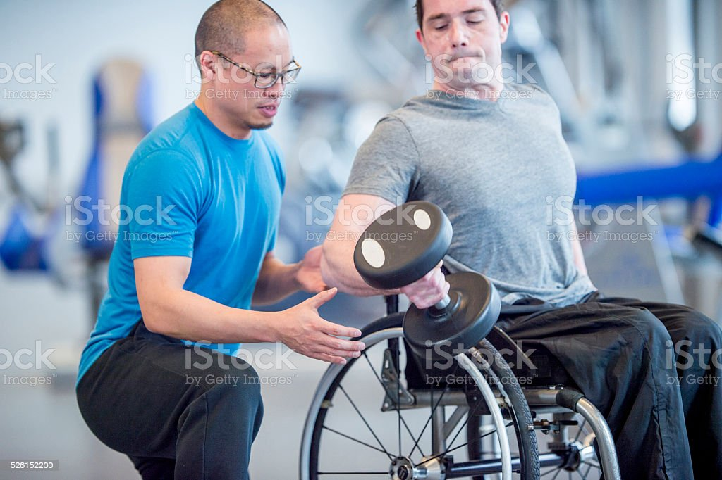Working with a Personal Trainer stock photo