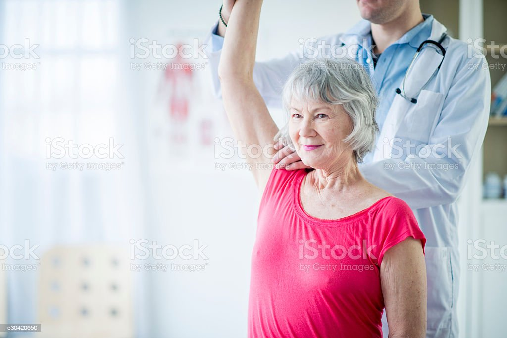 Working with a Physical Therapist stock photo