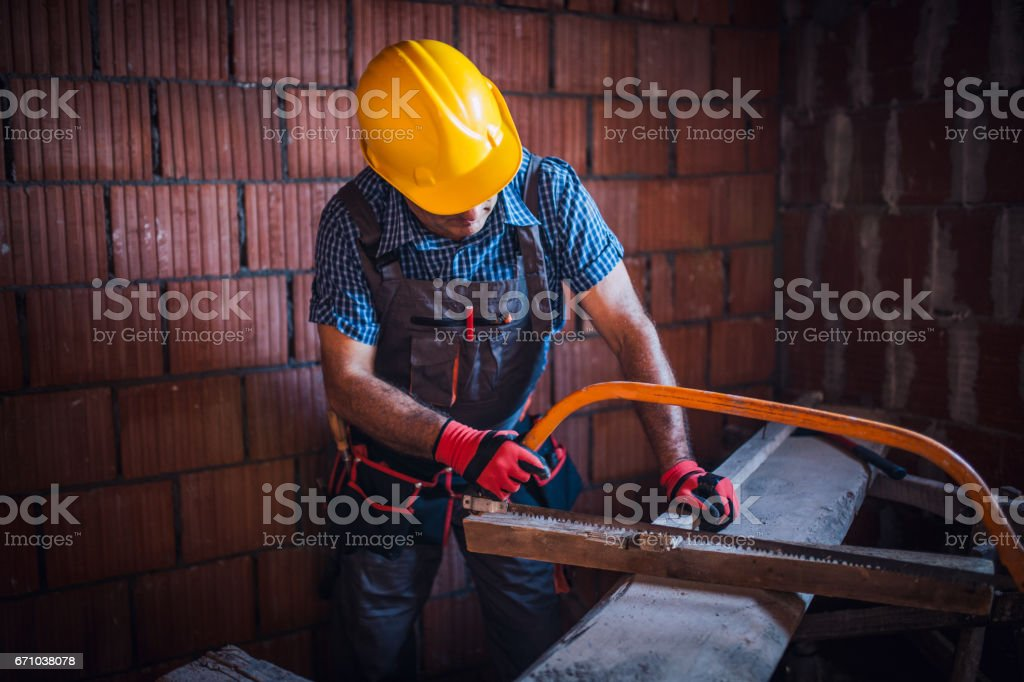 Working with a saw stock photo