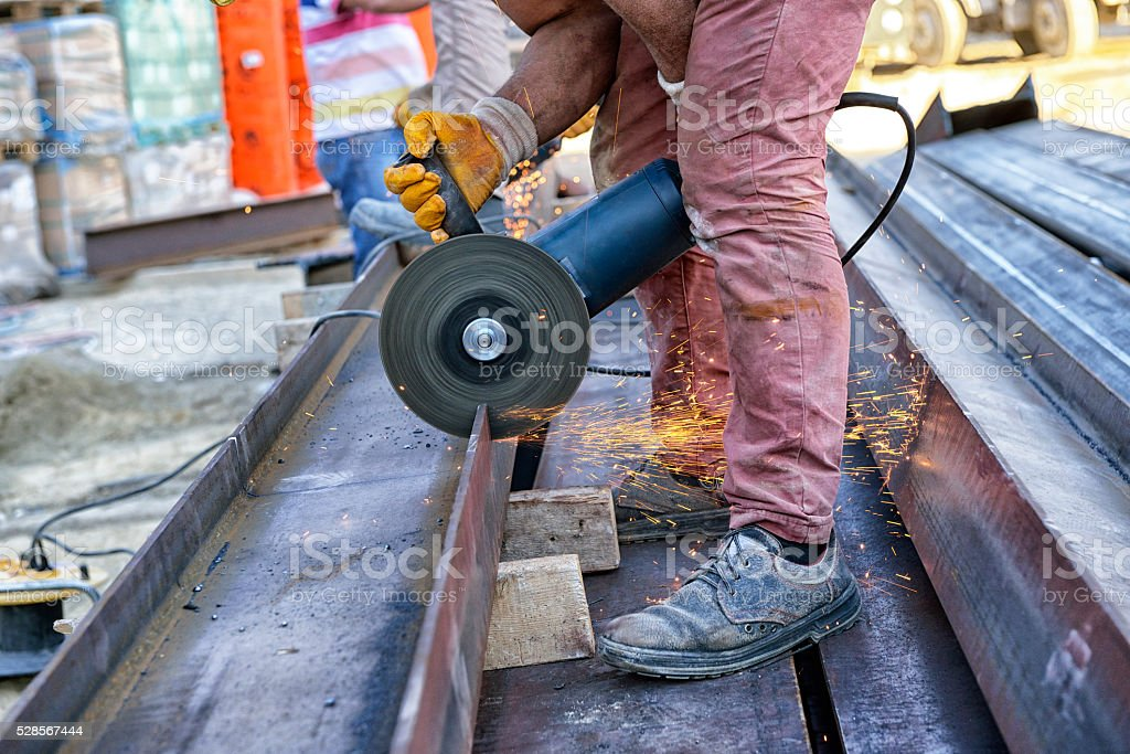 Working with Angle Grinder stock photo