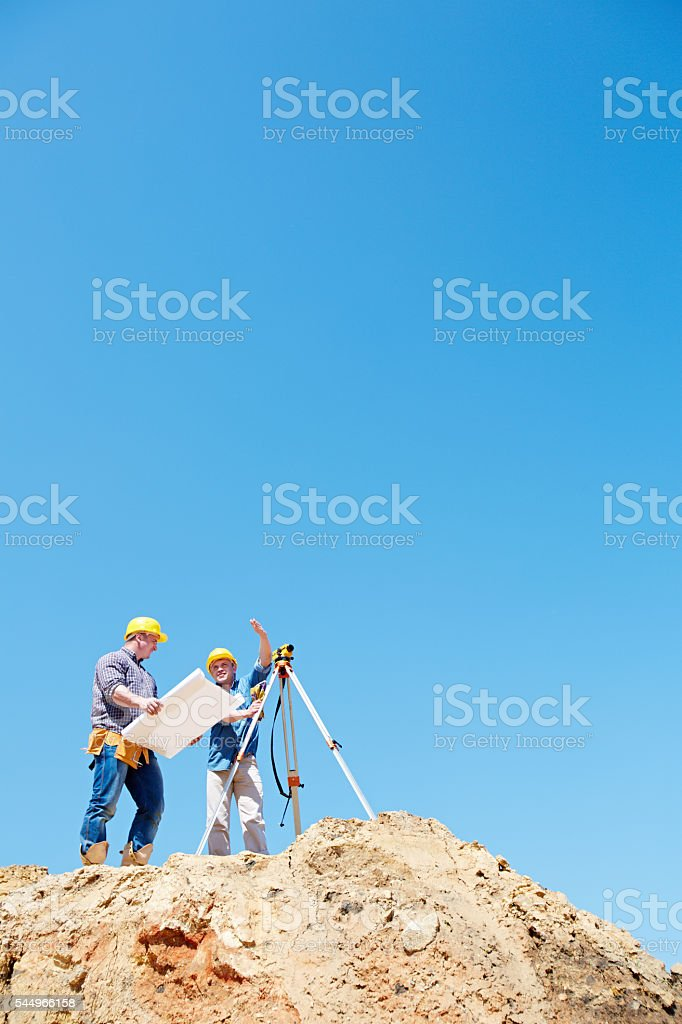 Working with blueprints and total station stock photo