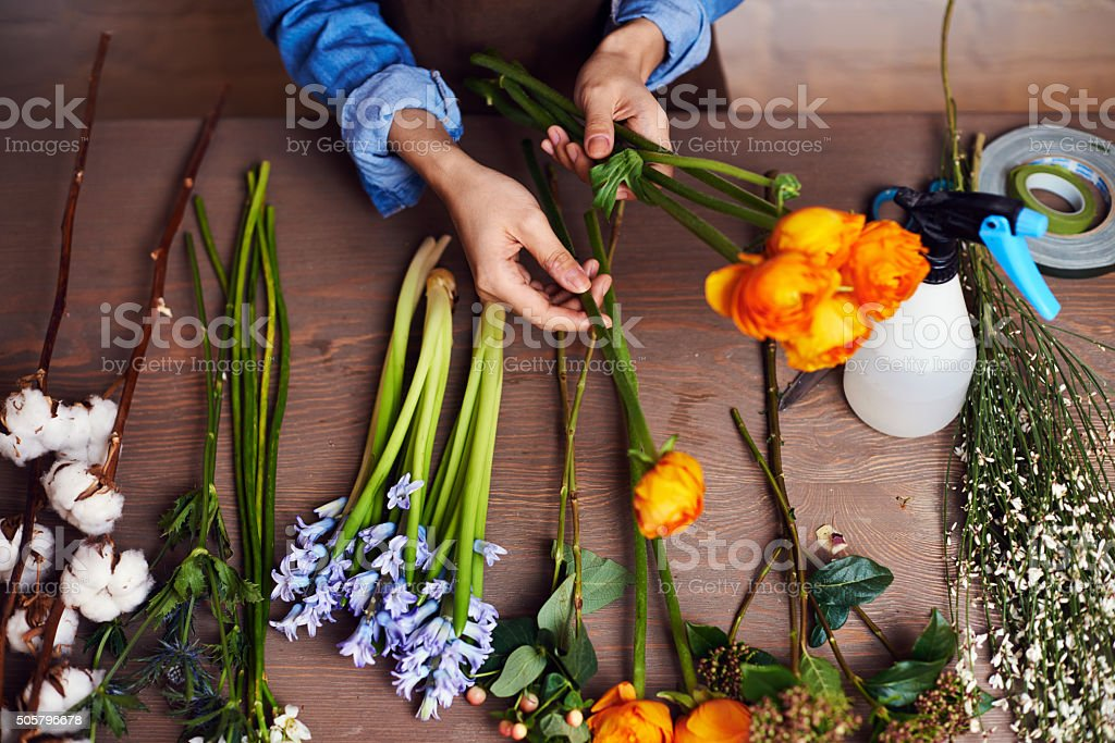 Hands of florist making a beautiful bouquet