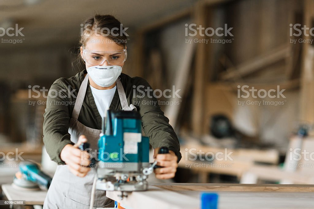 Working with fretsaw stock photo
