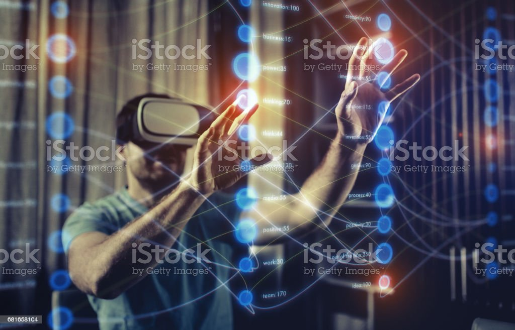 Working with futuristic charts in Virtual Reality Glasses stock photo