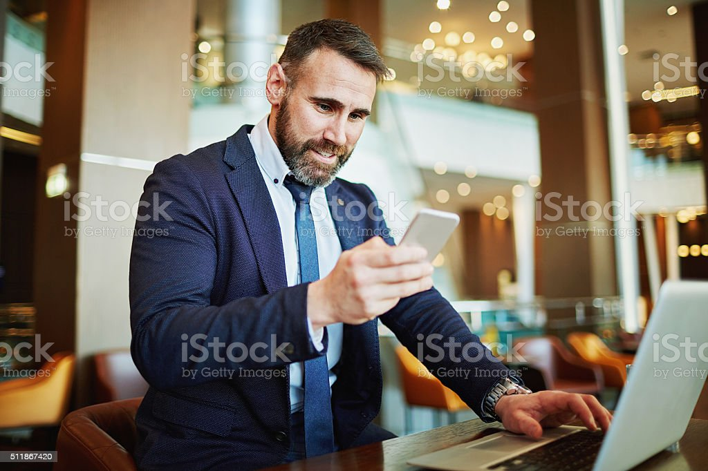 Working with gadgets stock photo
