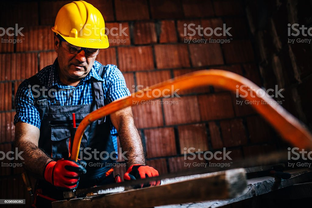 Working with handsaw stock photo