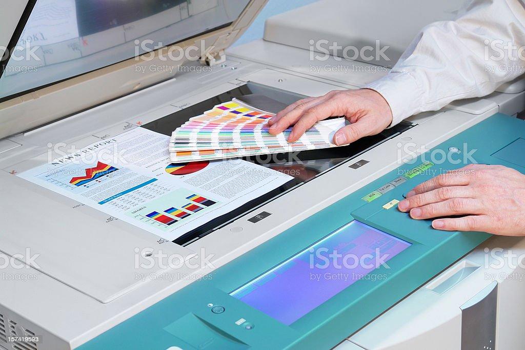 Working with Photocopier Machine stock photo