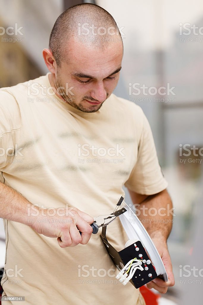 Working with Pliers royalty-free stock photo