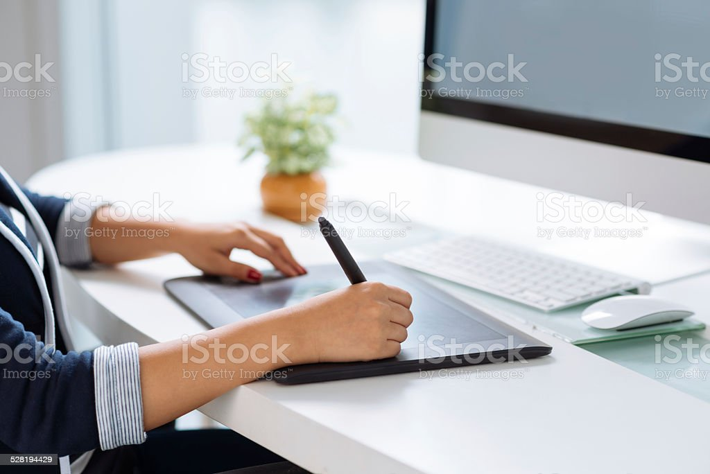 Working with stilus stock photo