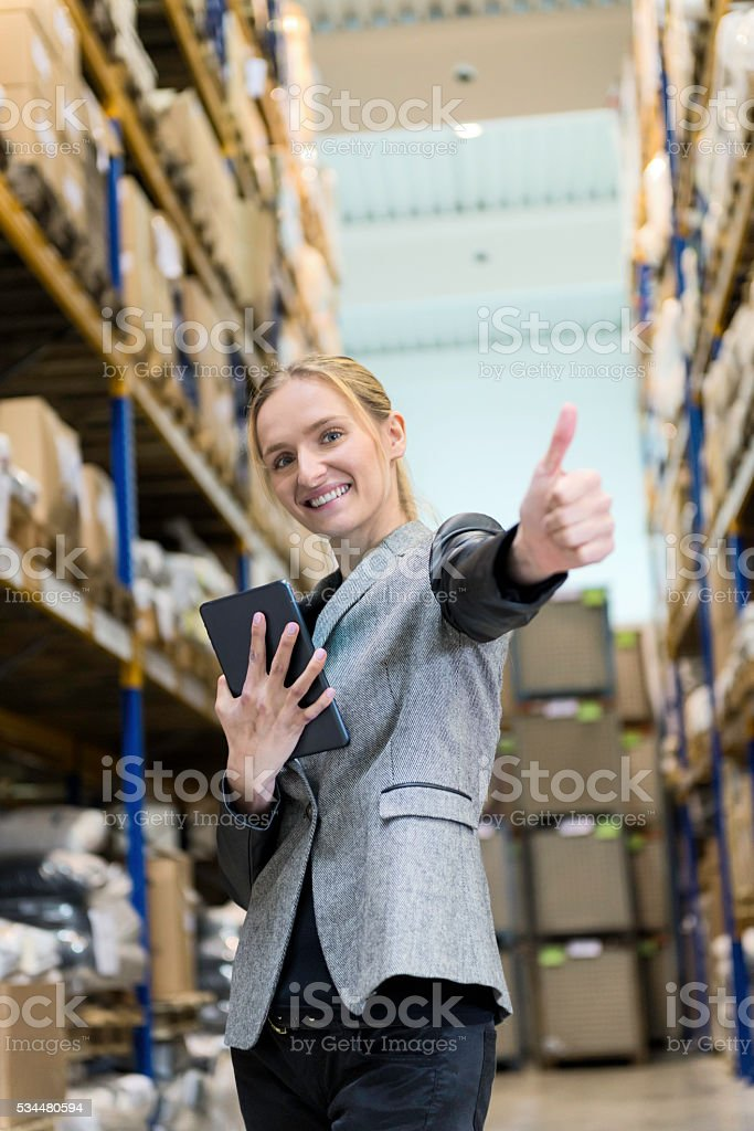 Working with success in warehouse stock photo