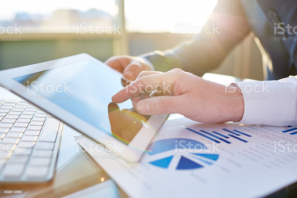 Working with tablet stock photo