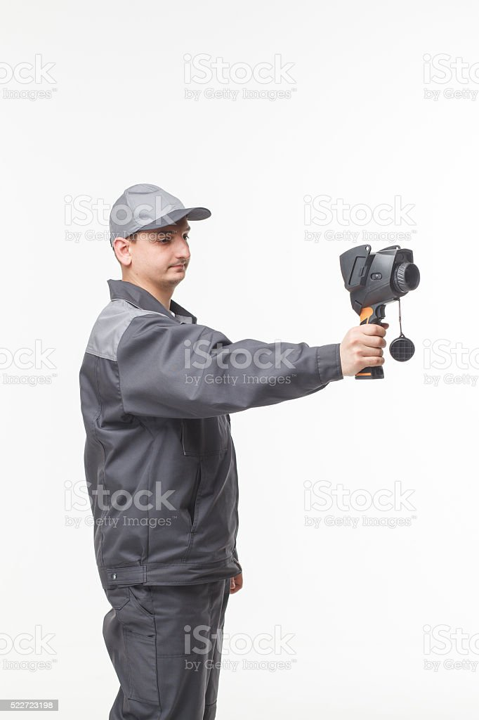 Working with the thermal imager in hands of stock photo