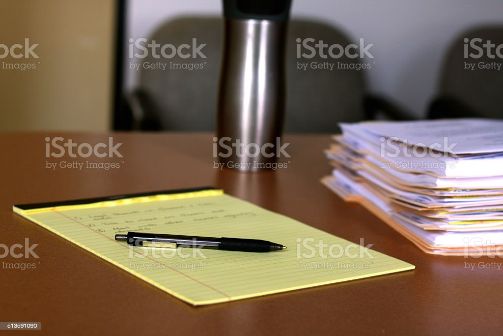 Working with Yellow Legal Pad stock photo