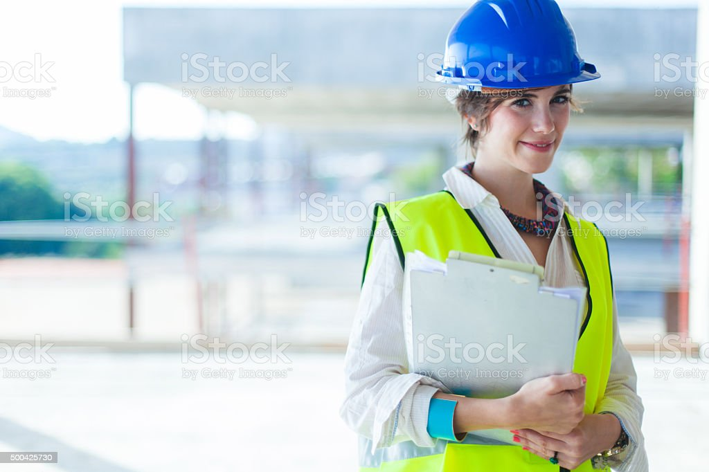 Working woman in a construction site. stock photo