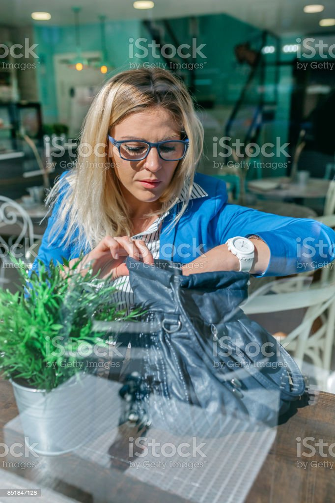 Working woman looking for mobile stock photo