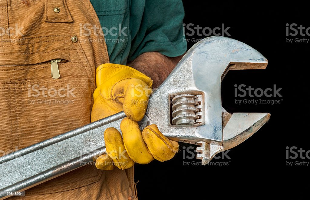 Workman and Large Wrench stock photo