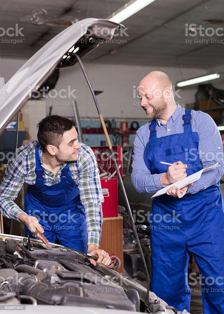 Workman calculating the price stock photo