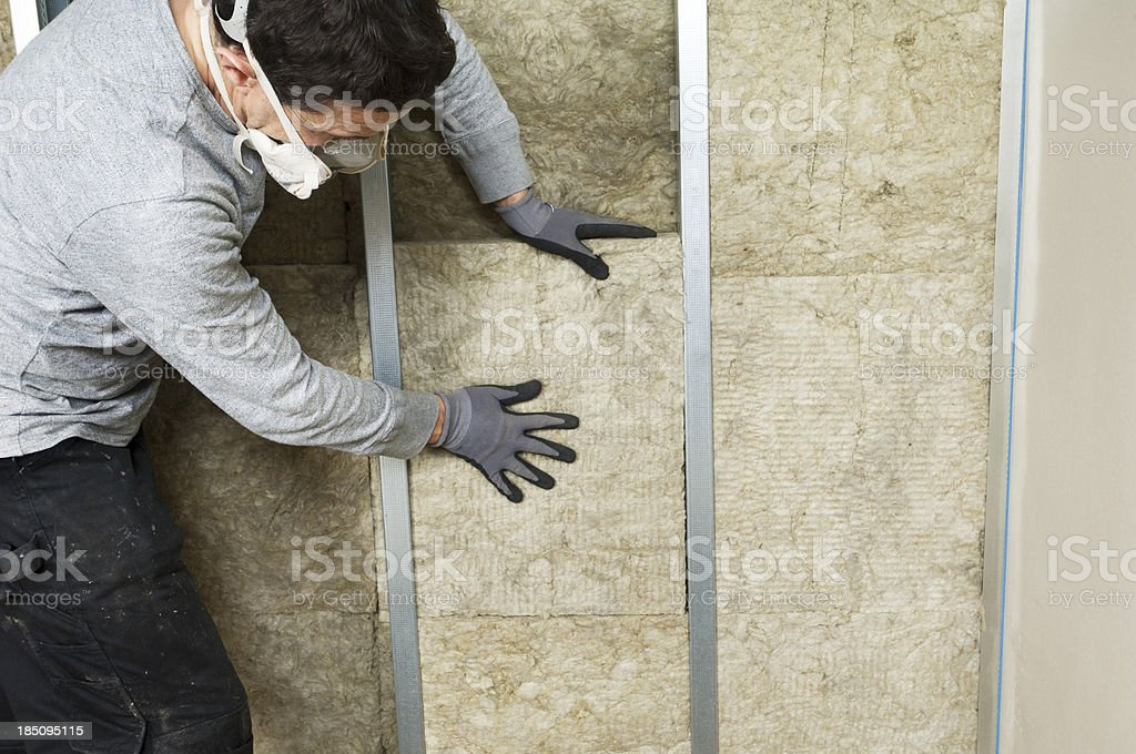 Workman Fitting Wall Insulation stock photo