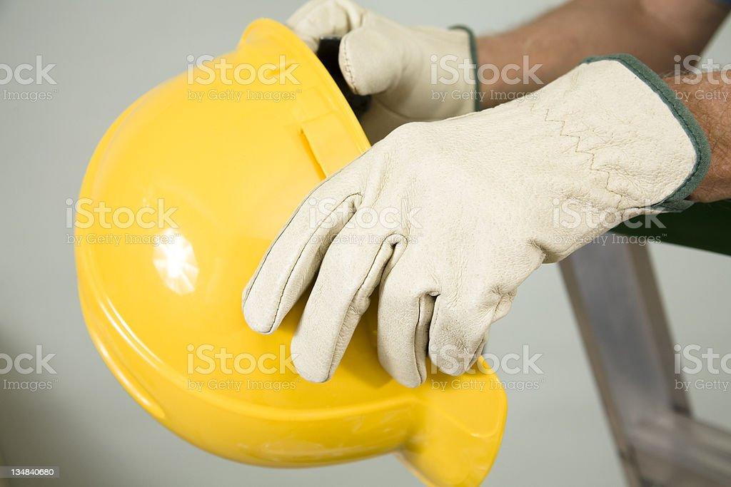 Workman holding hardhat royalty-free stock photo