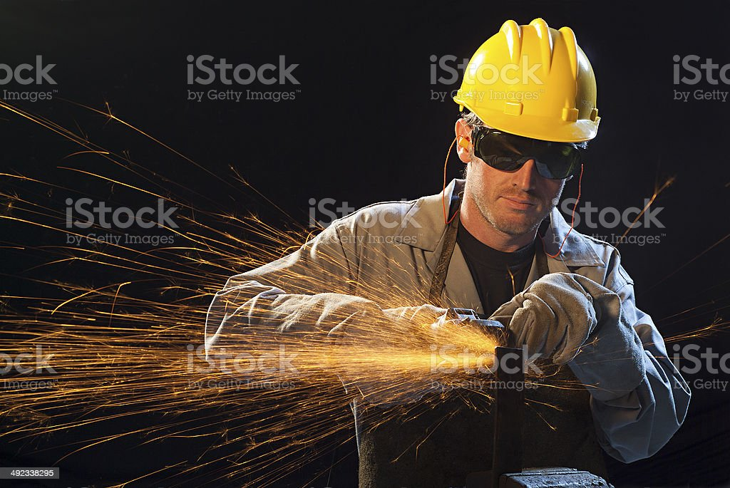 Workman in black background with sparkle stock photo