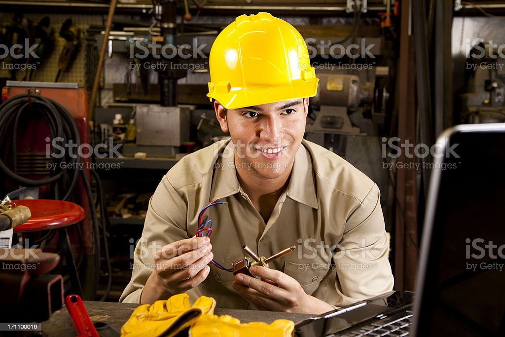 Workman searching computer for parts information royalty-free stock photo