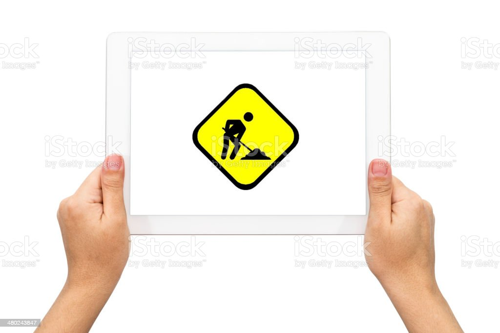 Workman sign, hand with tablet stock photo