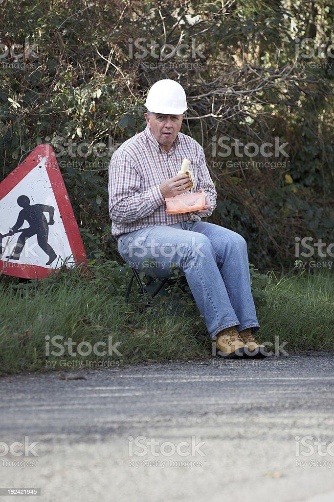 Workman taking his lunch break royalty-free stock photo