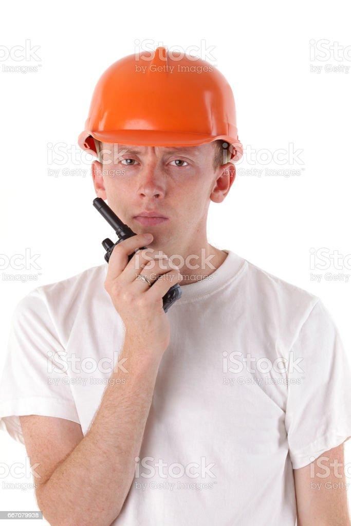 workman talking on portable UHF radio transceiver stock photo
