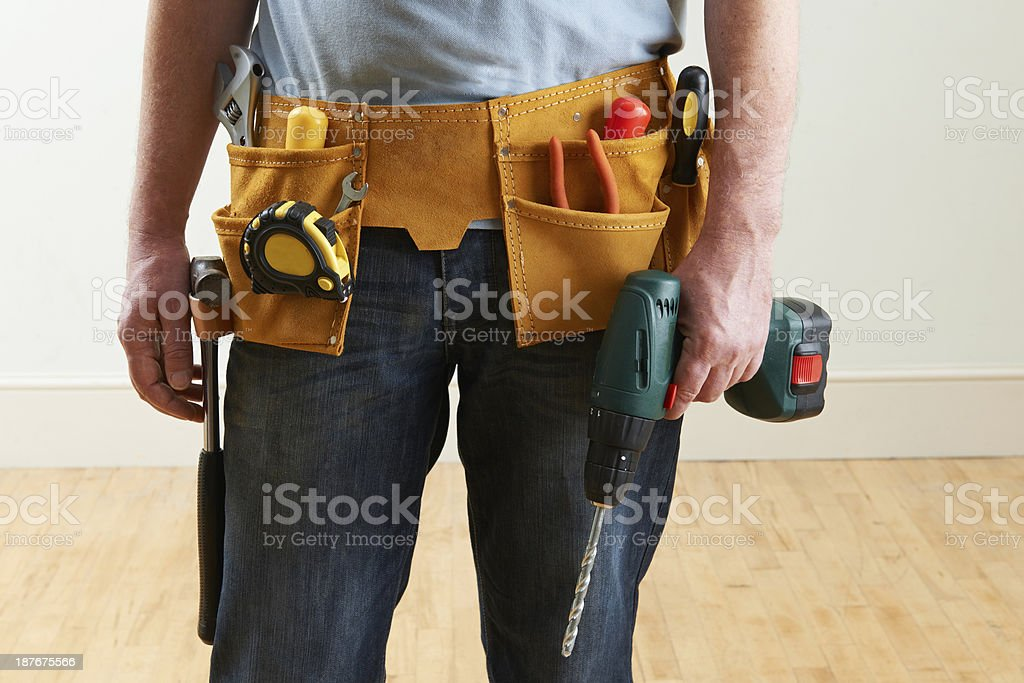 Workman Wearing Toolbelt royalty-free stock photo