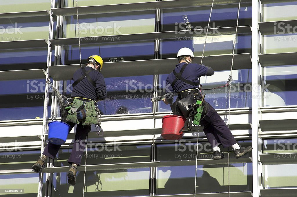 Workmen Abseiling A Corporate Building royalty-free stock photo