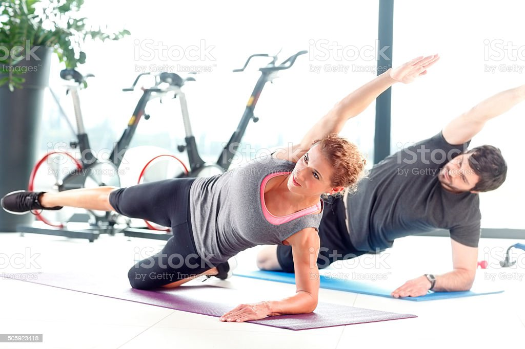 Workout at fitness club stock photo