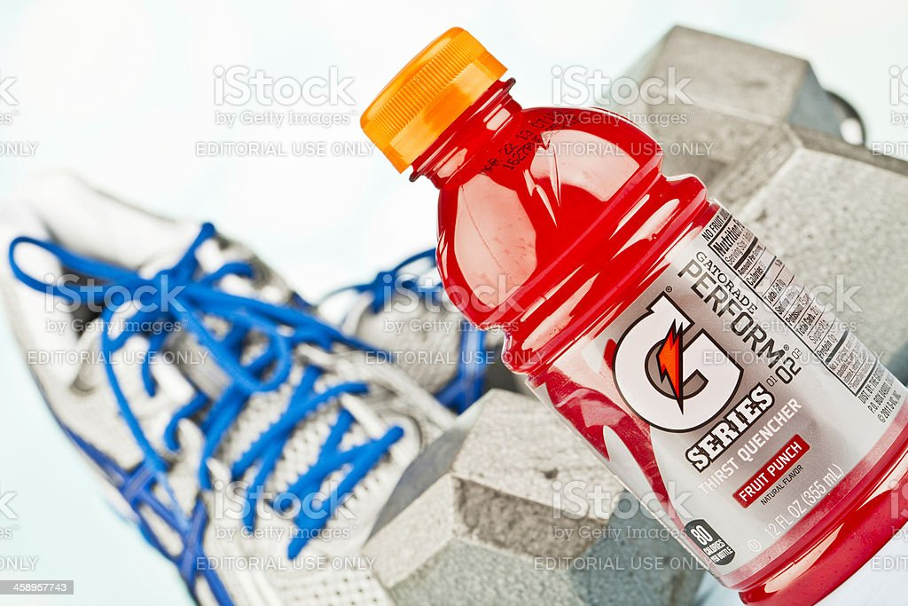 Workout Essentials: Sports Shoes, Dumbbells and Gatorade stock photo