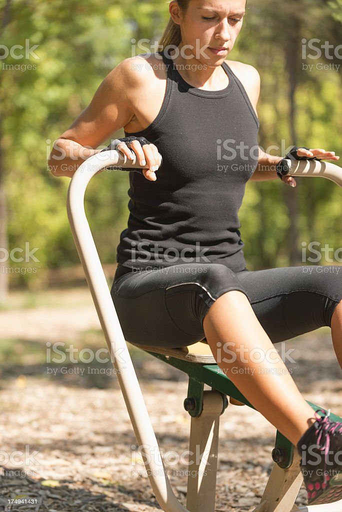 Workout on rowing machine royalty-free stock photo