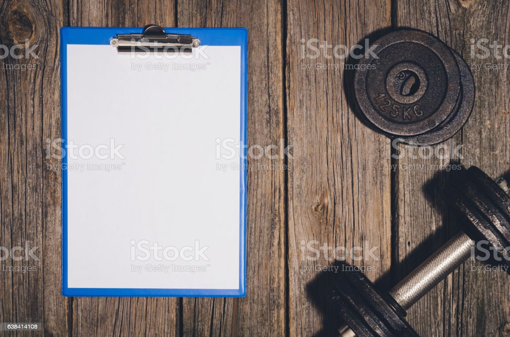 Workout Plan Background Dumbbells On Wooden Gym Floor Or Table Stock ...