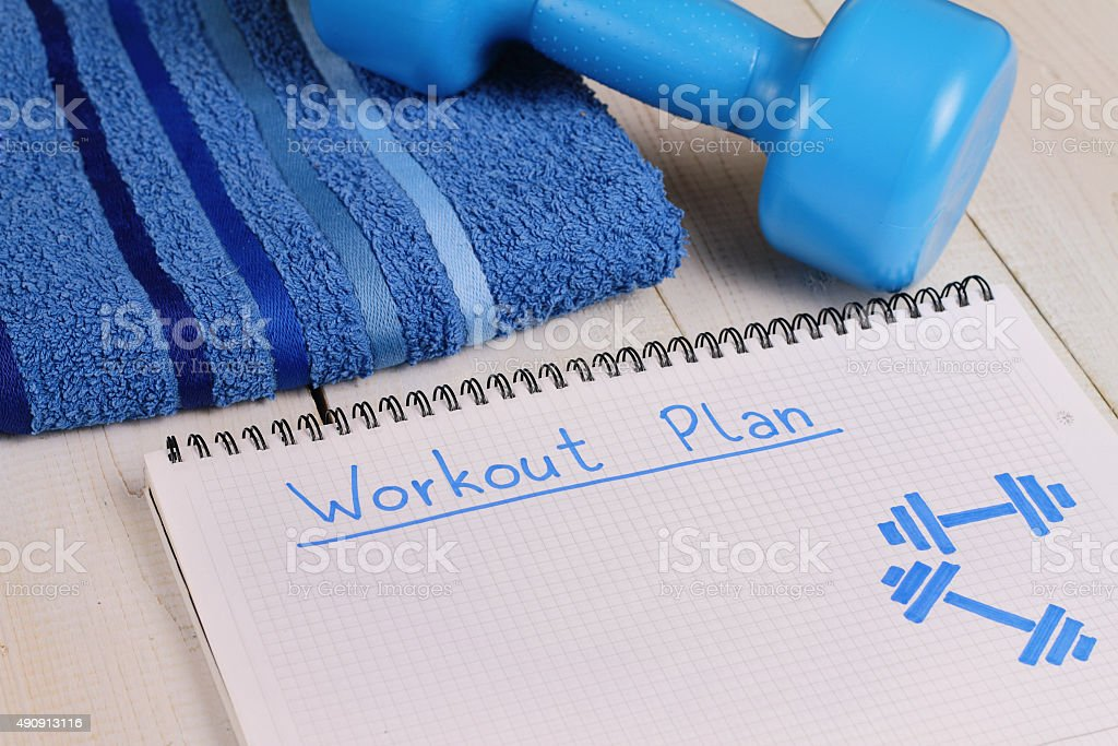 Workout plan,dumbbell and towel . Woman, fittness, sport concept stock photo