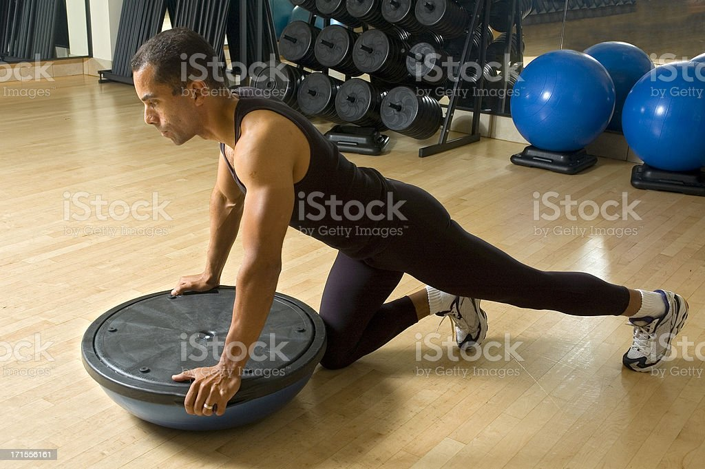 Workout with Bosu Ball royalty-free stock photo