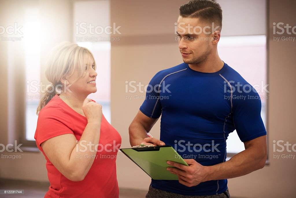 Workout with couch at fitness club stock photo