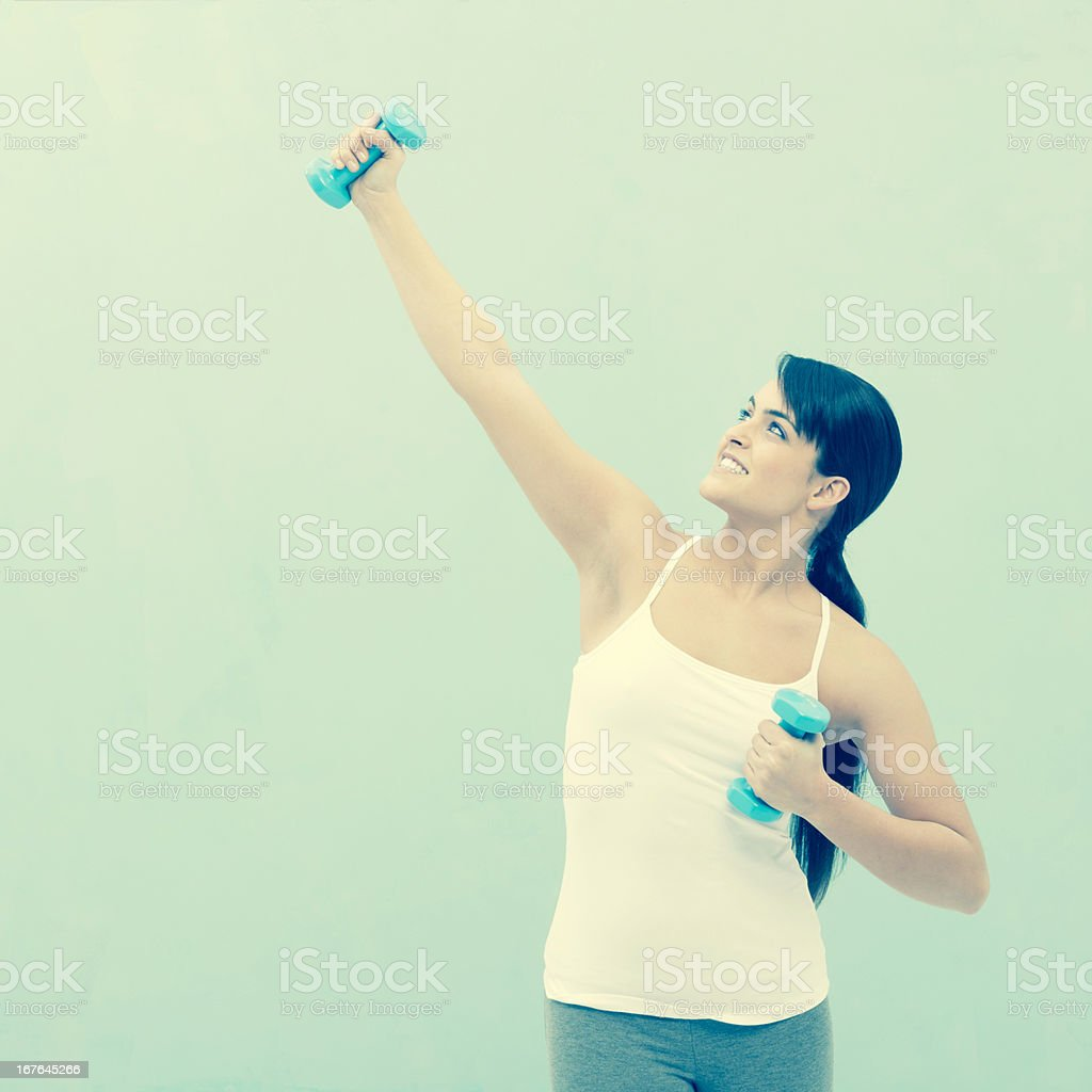 Workout with dumbbells royalty-free stock photo