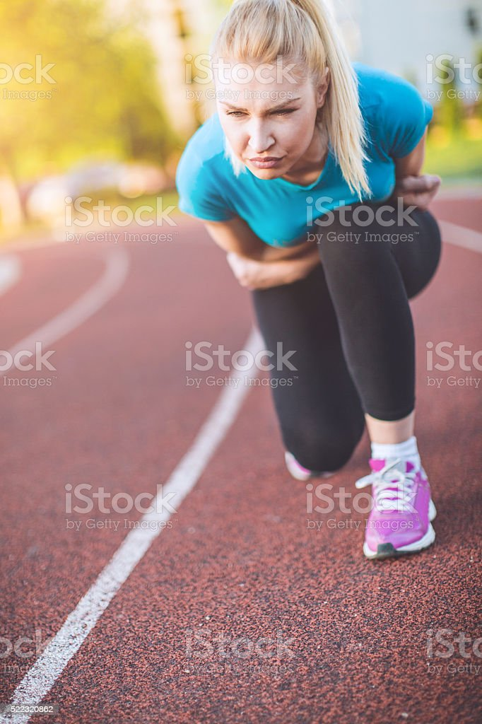workout woman in a pain stock photo