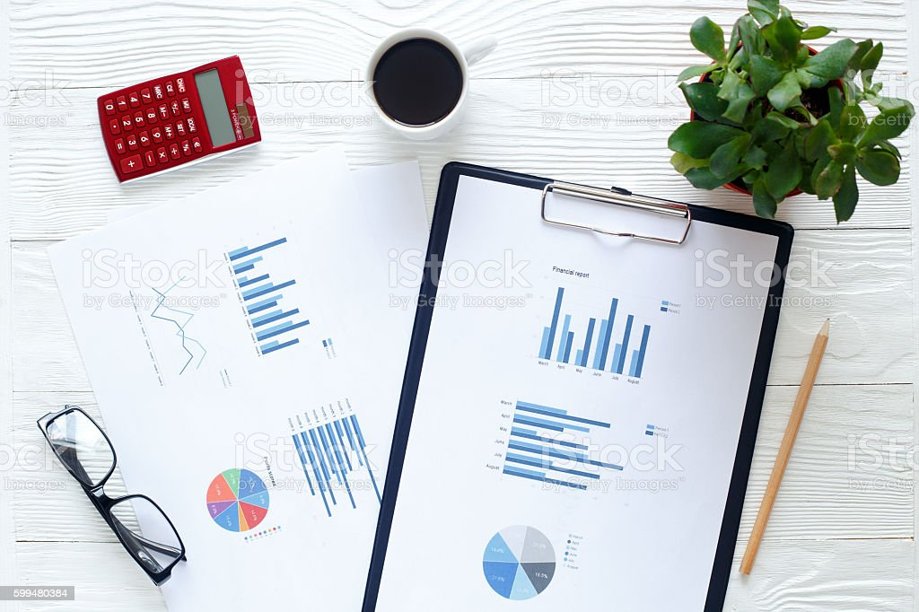 workplace economist at office table stock photo