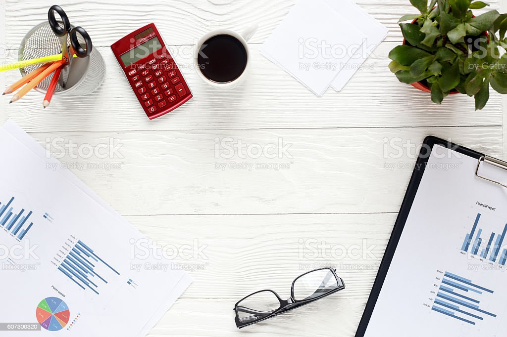 workplace economist on white office table with space for text stock photo