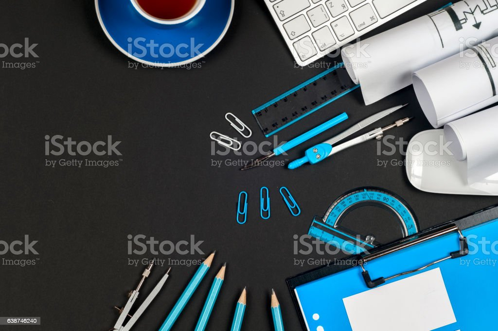 Workplace of architect - rolls and plans. stock photo