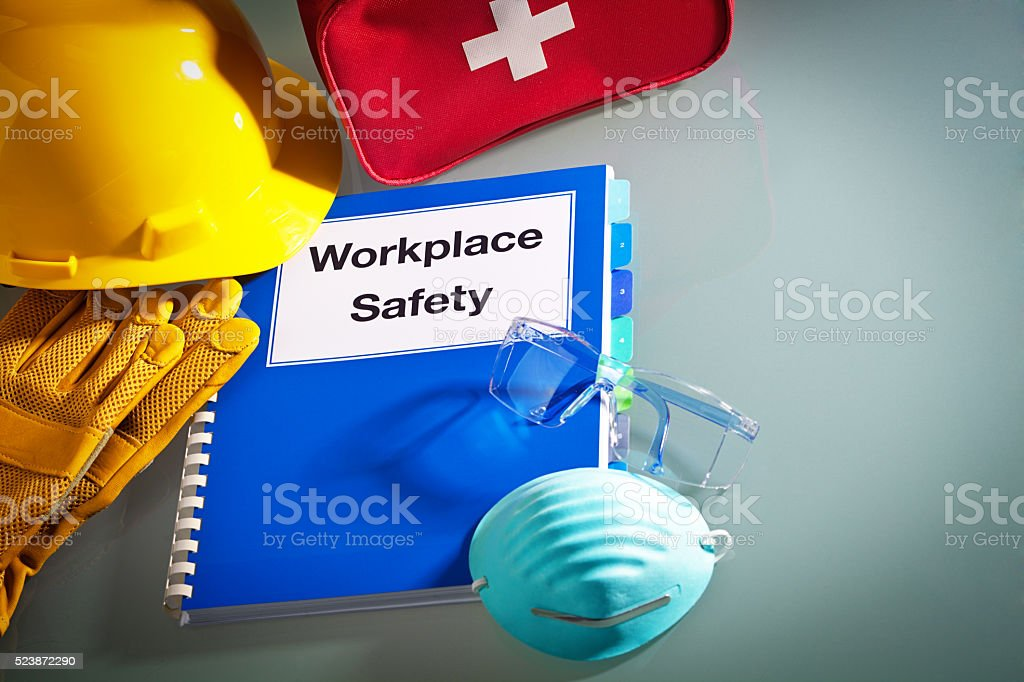 Workplace Safety Manual With Safety Equipment Stock Photo