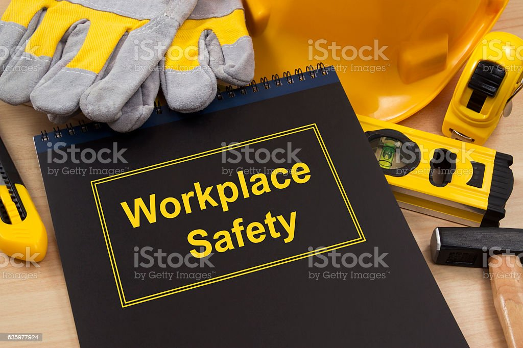Workplace Safety Manual with Work Equipment stock photo